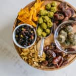 Overhead shot of dried fruit and healthy snacks on wood board