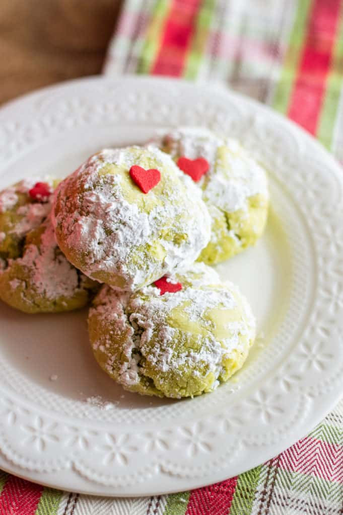 Grinch cookies green with red hard on a white plate