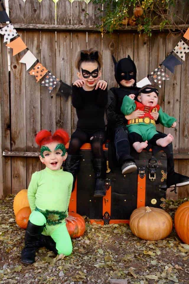 Kids dressed up in Batman themed costumes