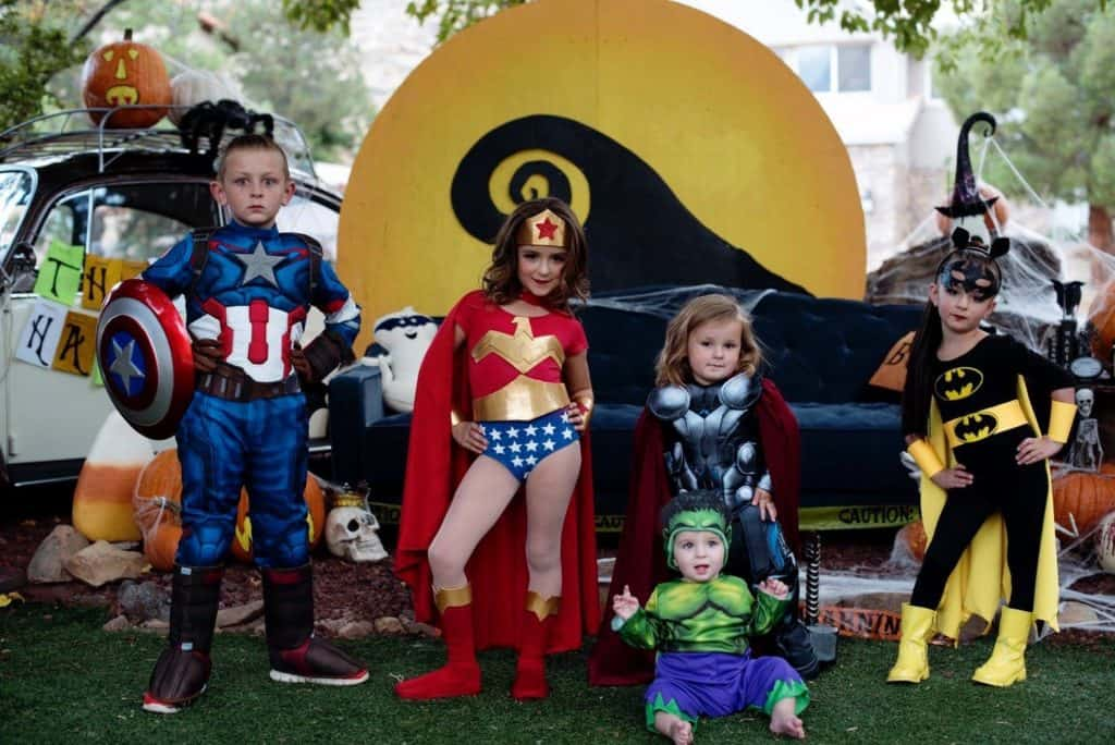 Kids dressed up in superhero costumes