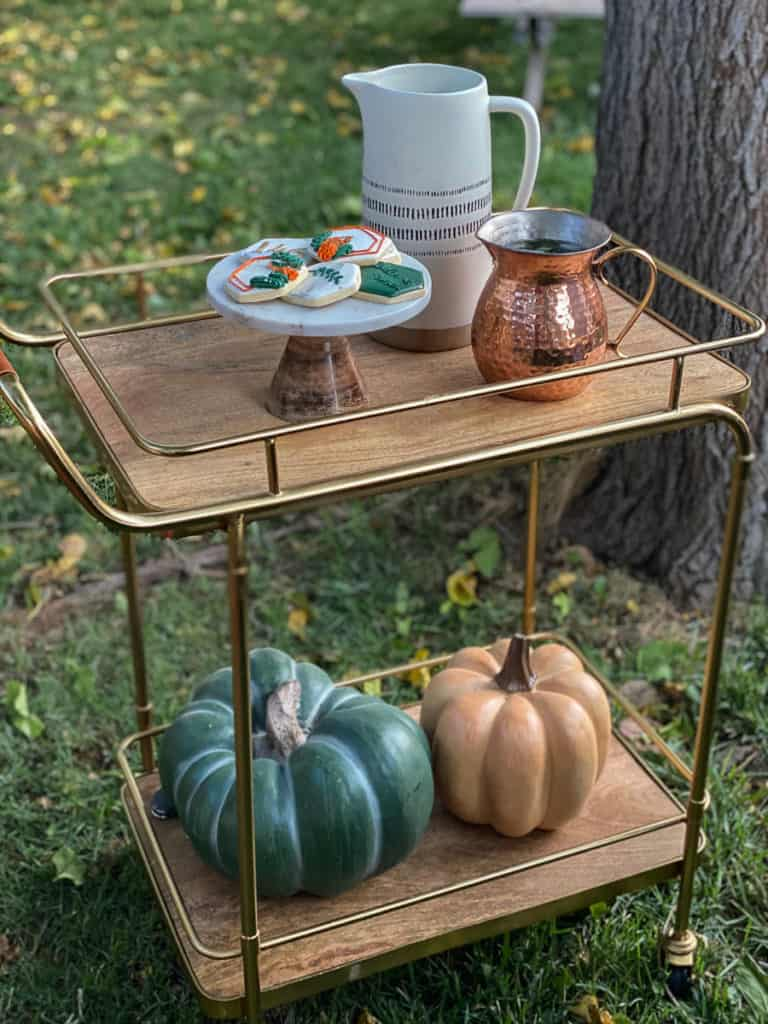 Bar cart with cookies, pumpkins and pitchers