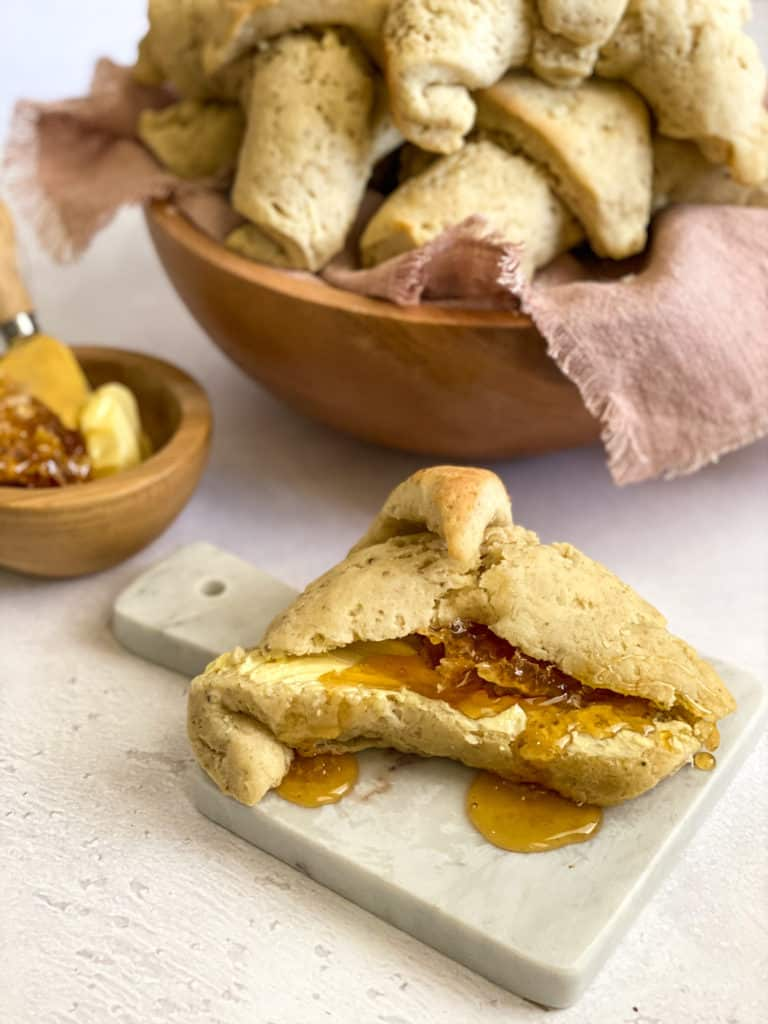 gluten-free sourdough crescent rolls with honey and butter