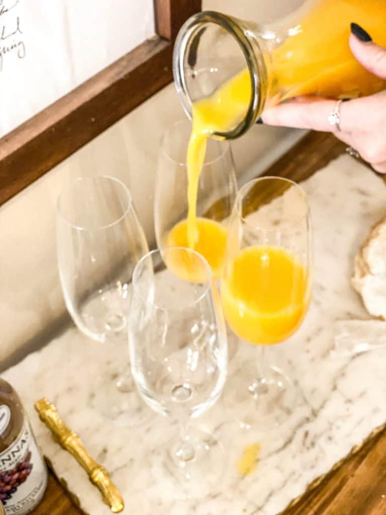 Orange juice poured into champagne glasses