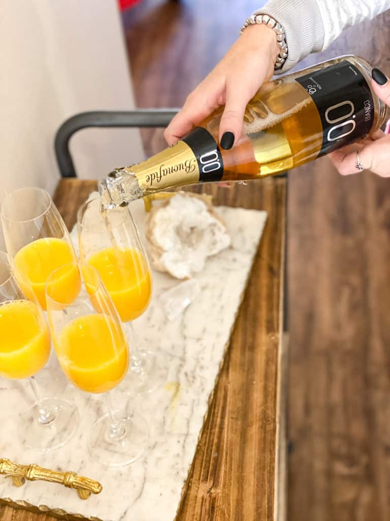 Mimosa mocktails being made