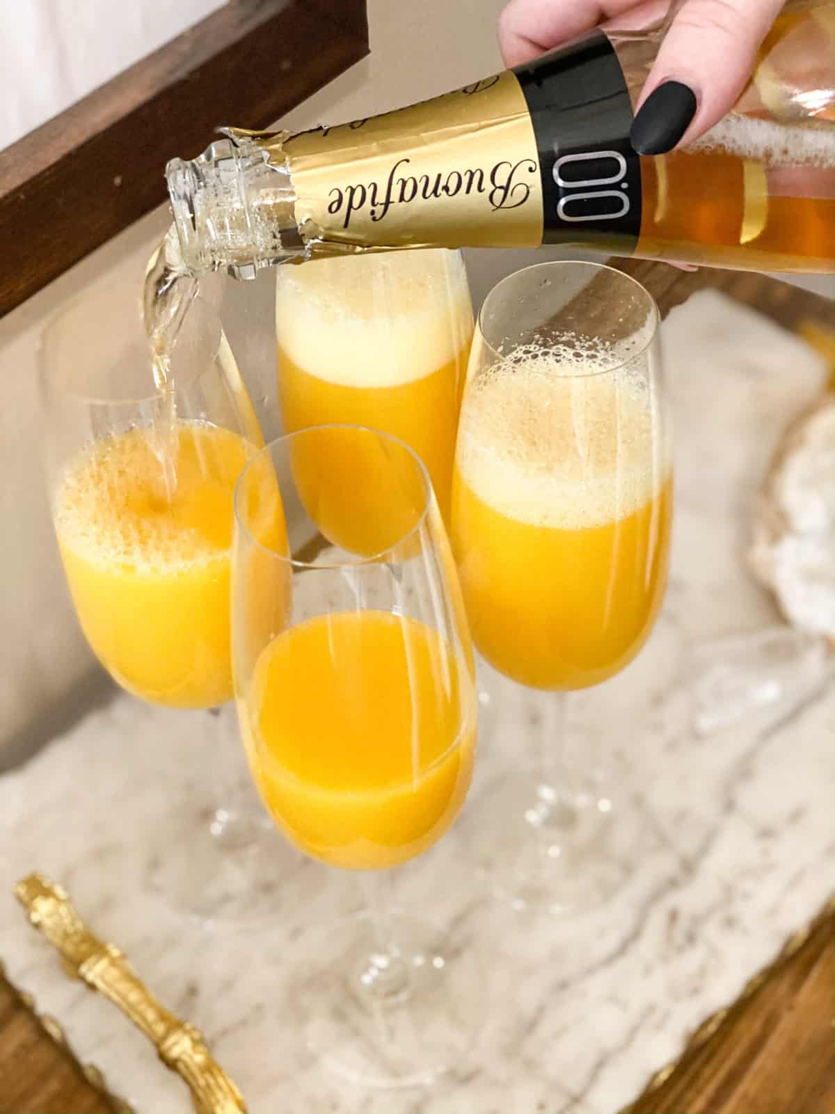 Mimosa Mocktail (Non-Alcoholic) being poured