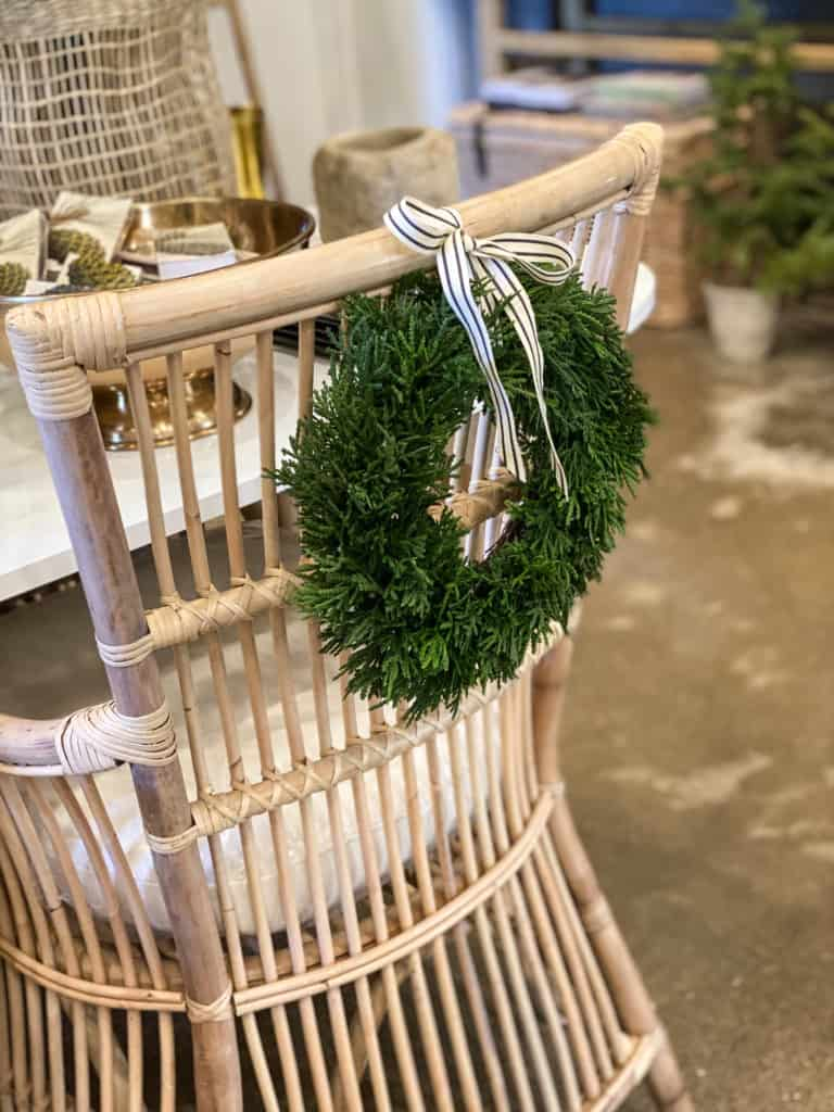 Green wreaths on chairs