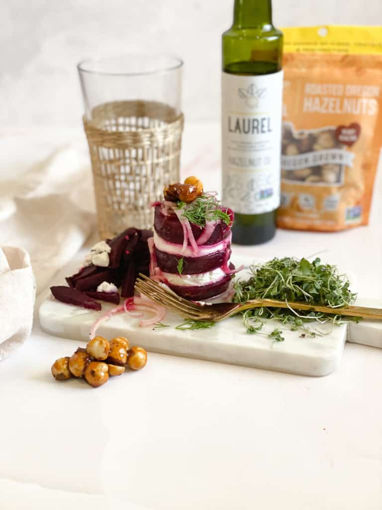 Hazelnut oil beet and goat cheese salad with candied hazelnuts