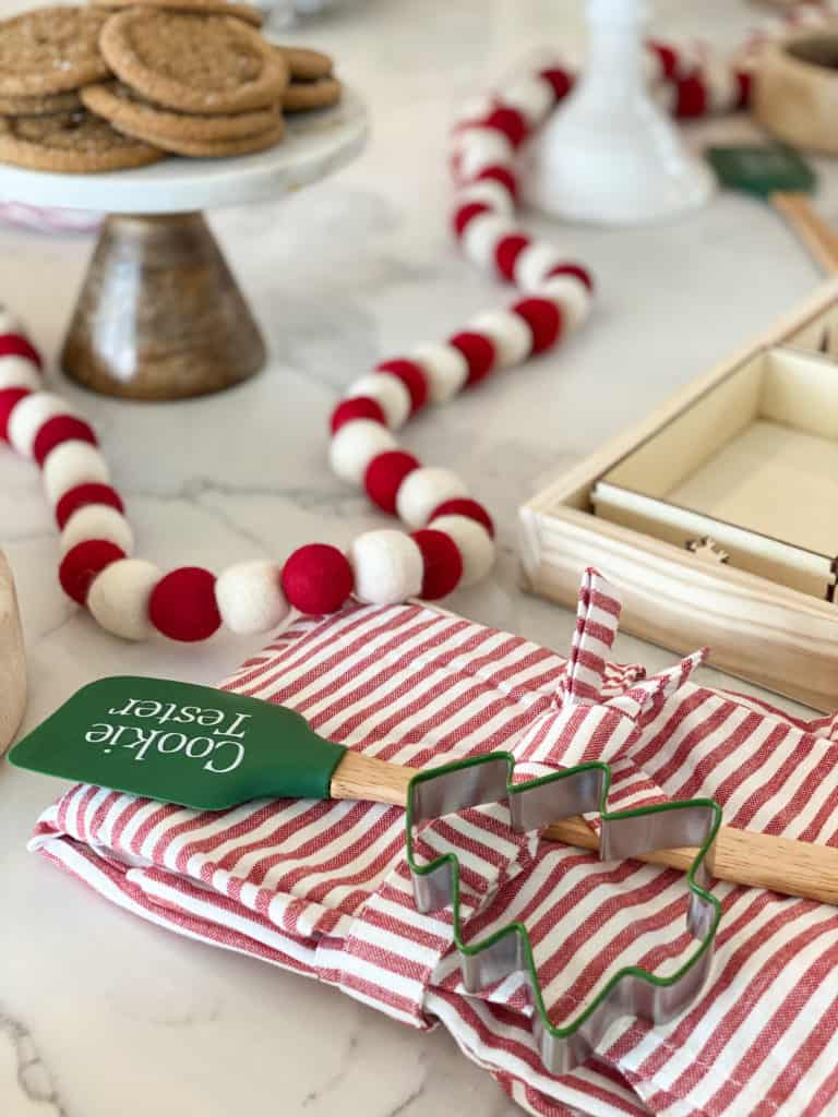 A spatula and holiday apron with cookie cutter