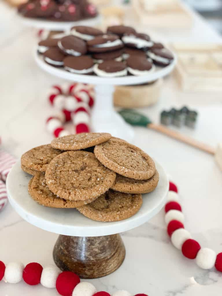 Ginger molasses cookies on a cake stand