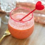 Strawberry basil margarita mocktail in a cup with a heart stirrer