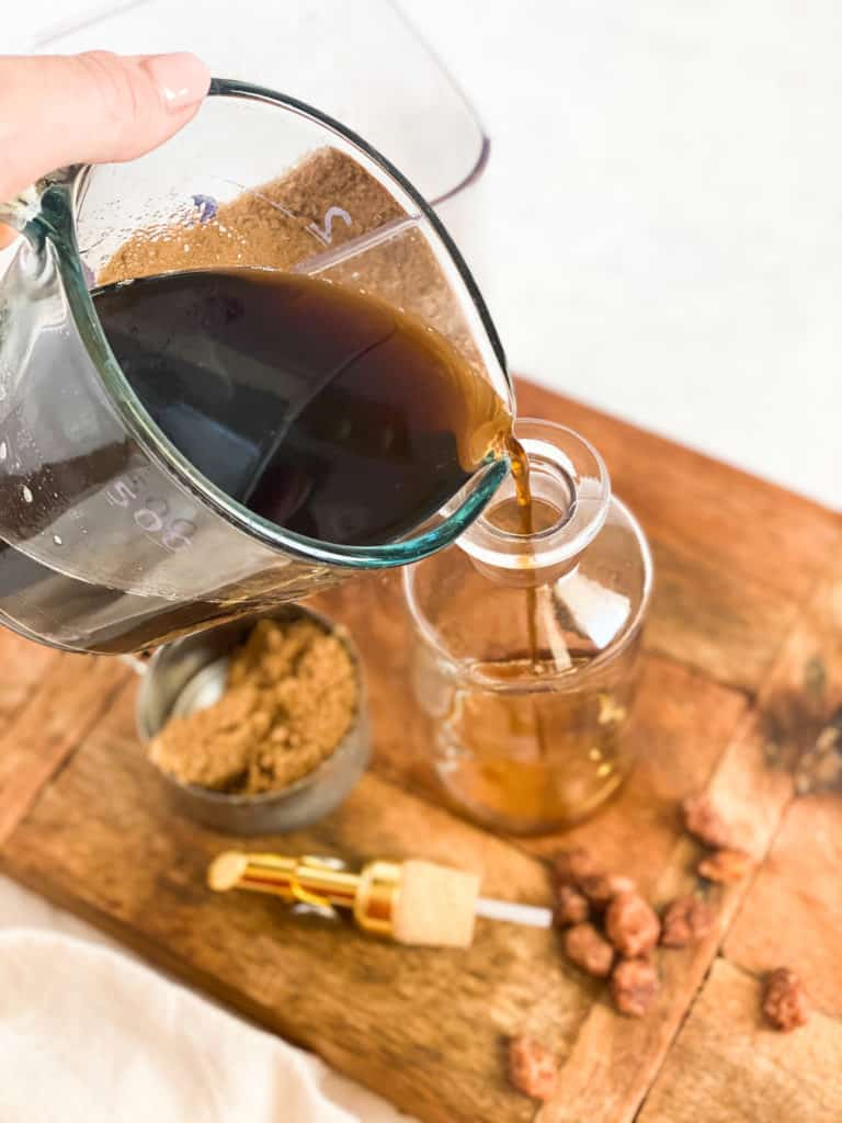 Brown Sugar Simple Syrup being poured into a glass