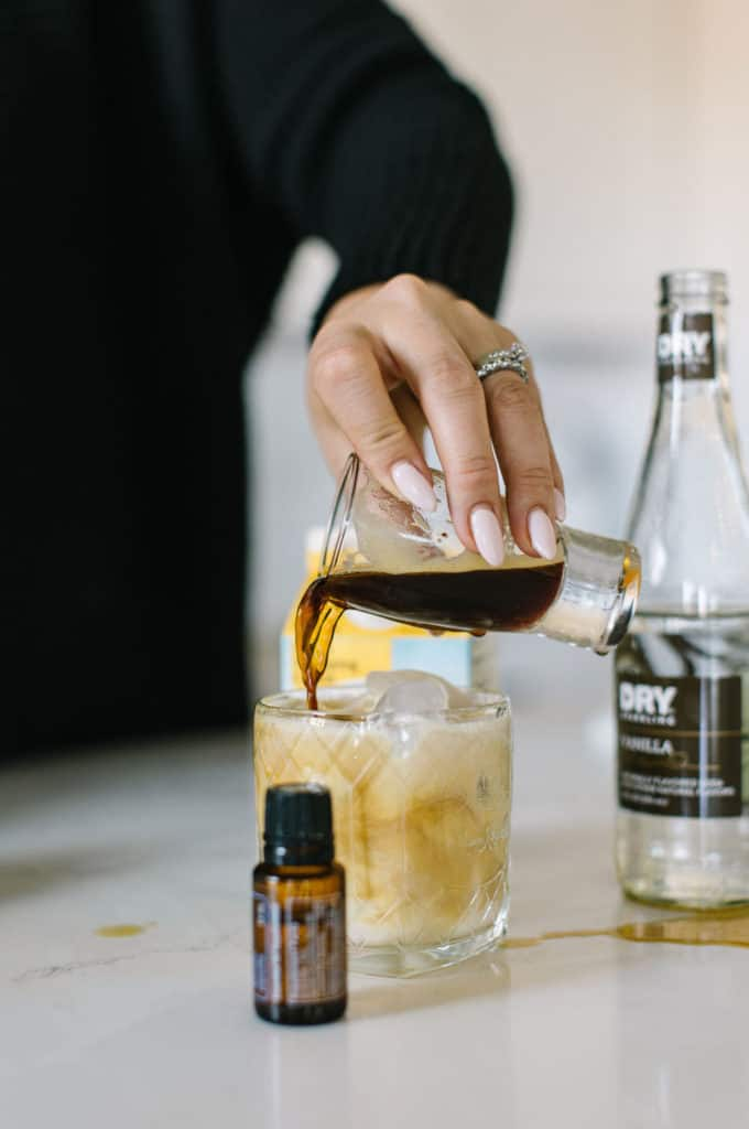 Coffee being poured into White Russian mocktail