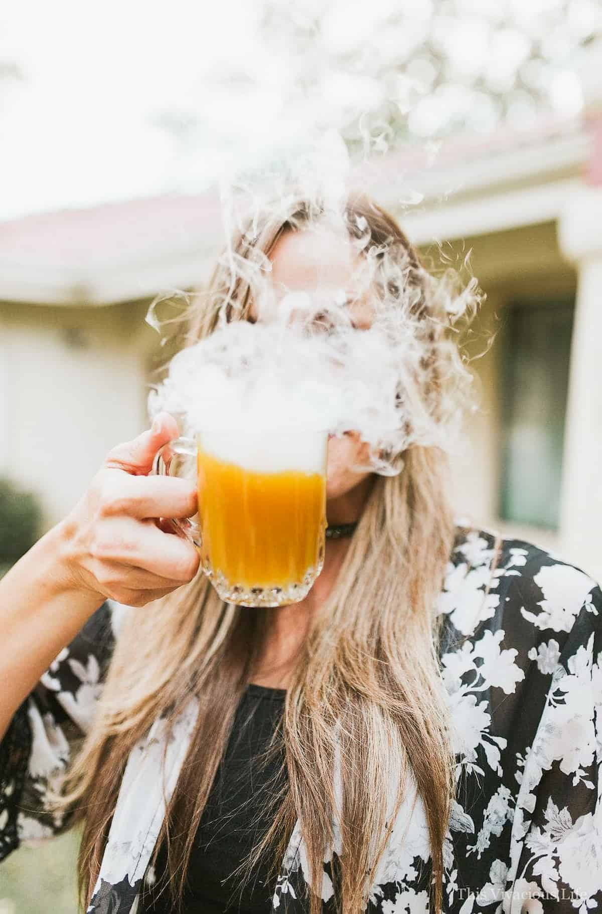 Pumpkin punch in front of a face smoking