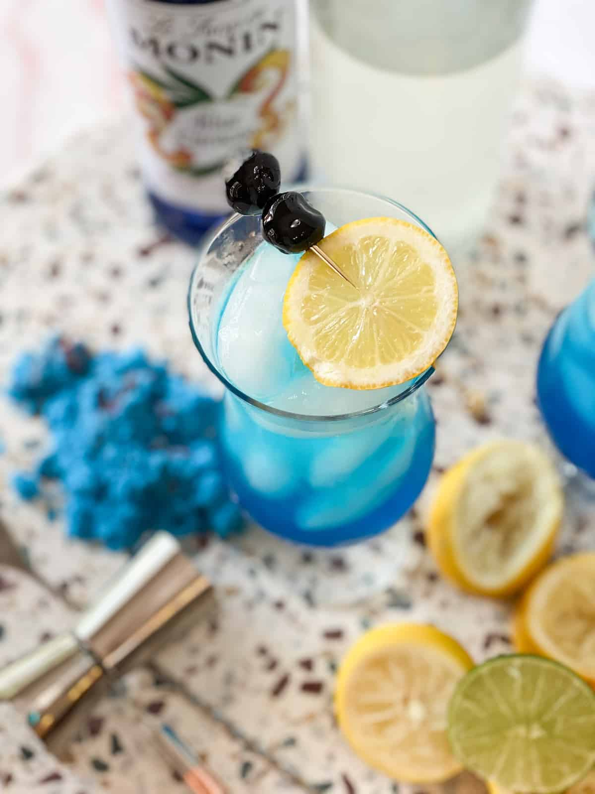 Blue lagoon mocktail in a glass with lemon