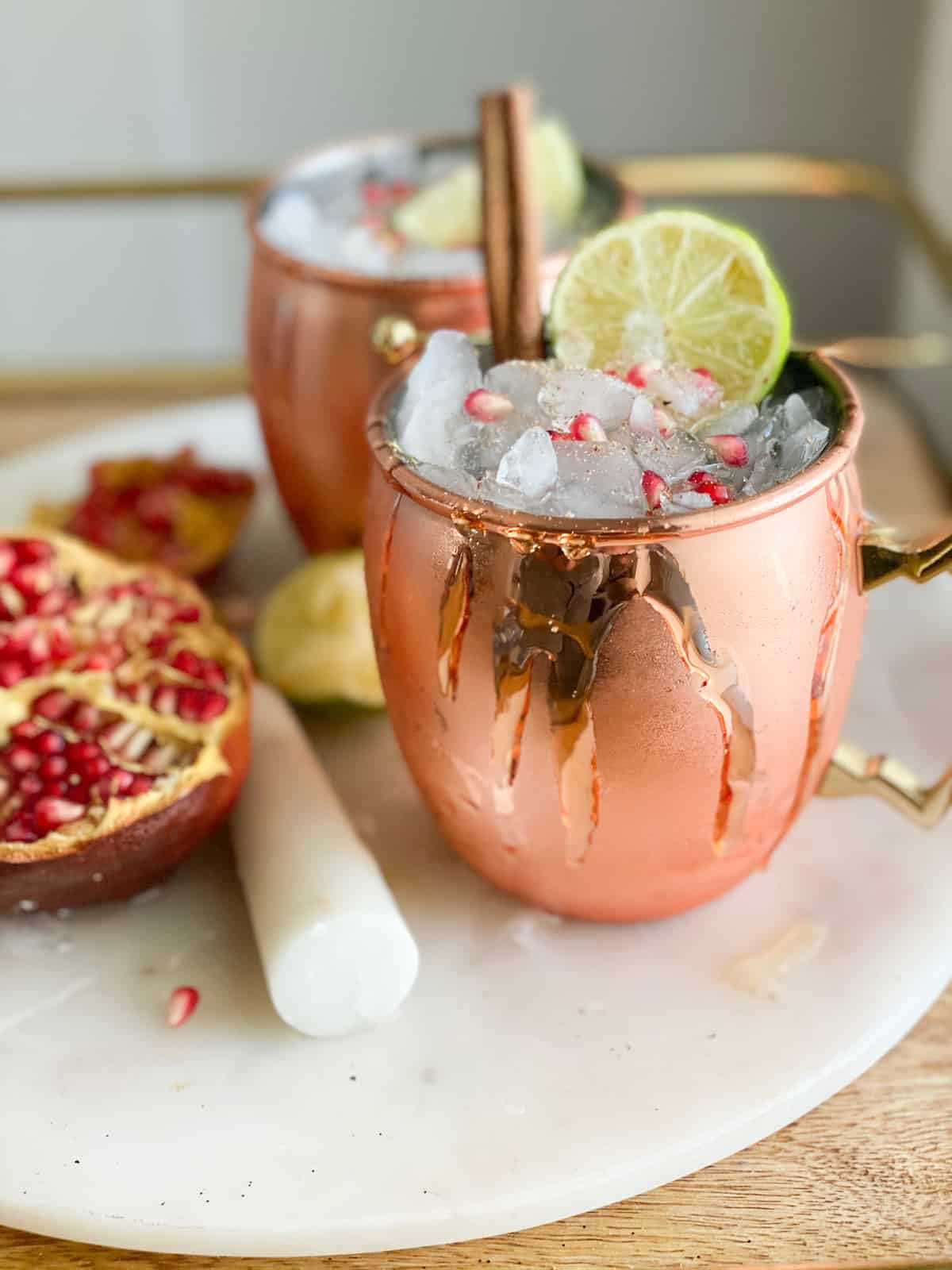 Thanksgiving mocktails in a copper cup with cinnamon sticks