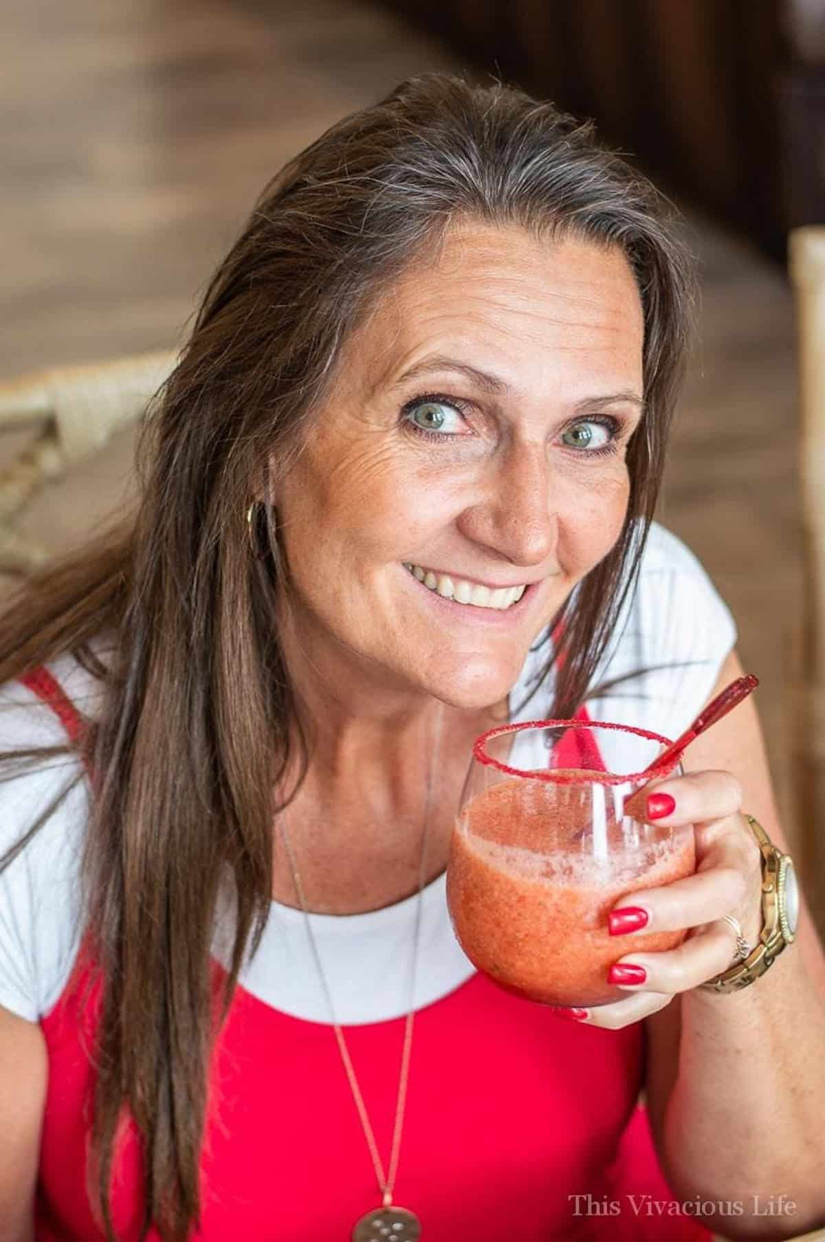 Virgin Strawberry Margarita Mocktail in a woman's hand