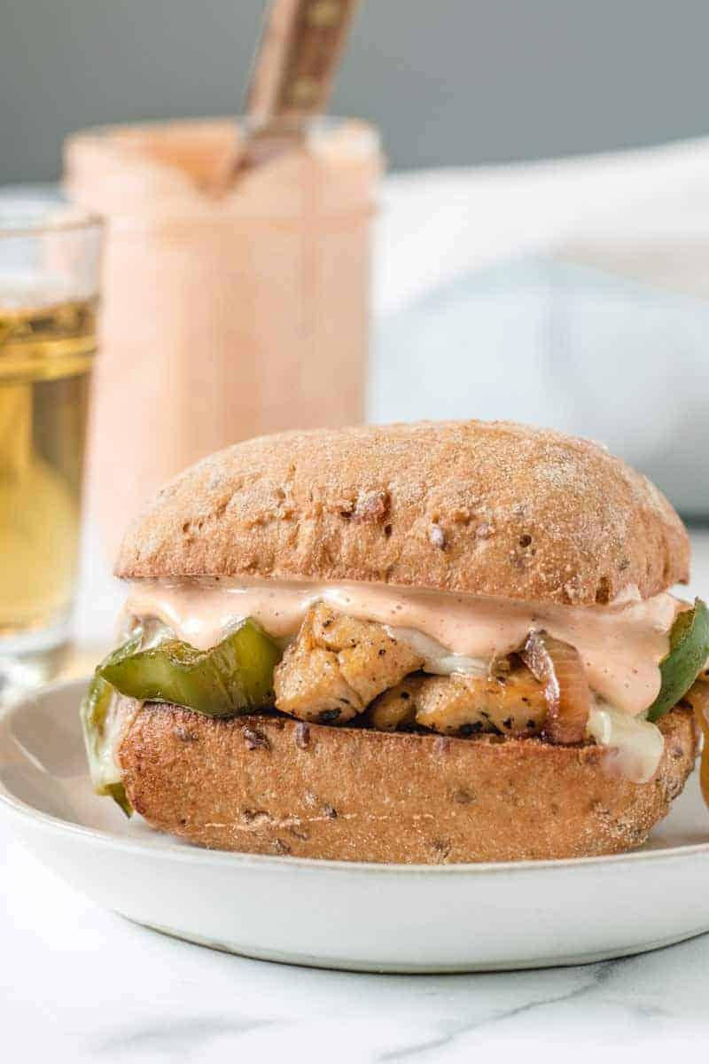 Chipotle chicken cheesesteak sandwich with sauce on GF bread